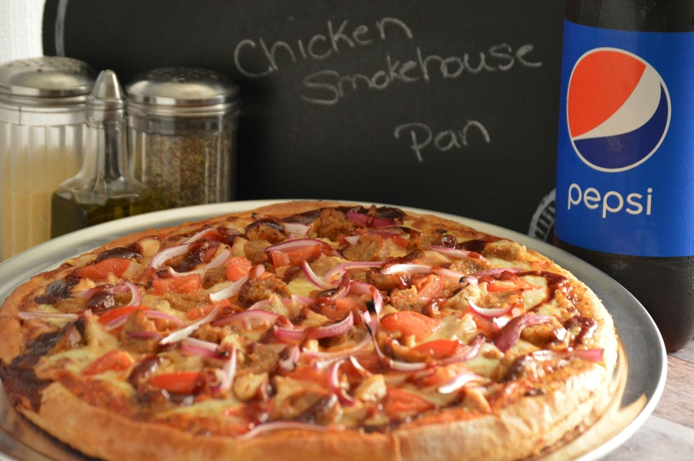 CHICKEN SMOKEHOUSE PAN: Pizza sauce, roasted chicken strips, tomatoes, hot sausage, onions, mozzarella and provolone topped with BBQ drizzle . (ONLY AVAILABLE IN PAN CRUST)