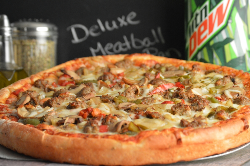 DELUXE MEATBALL: Marinara sauce, provolone cheese, meatballs, mushrooms, roasted peppers, roasted onions, and a blend of mozzarella and Romano cheese.