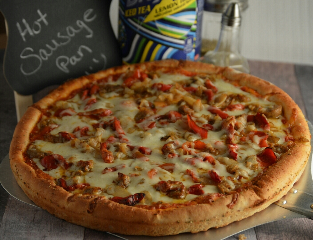 HOT SAUSAGE PAN: pizza sauce, provolone cheese, hot sausage, roasted peppers, and roasted onions. *Italian sausage or pork sausage can be substituted*