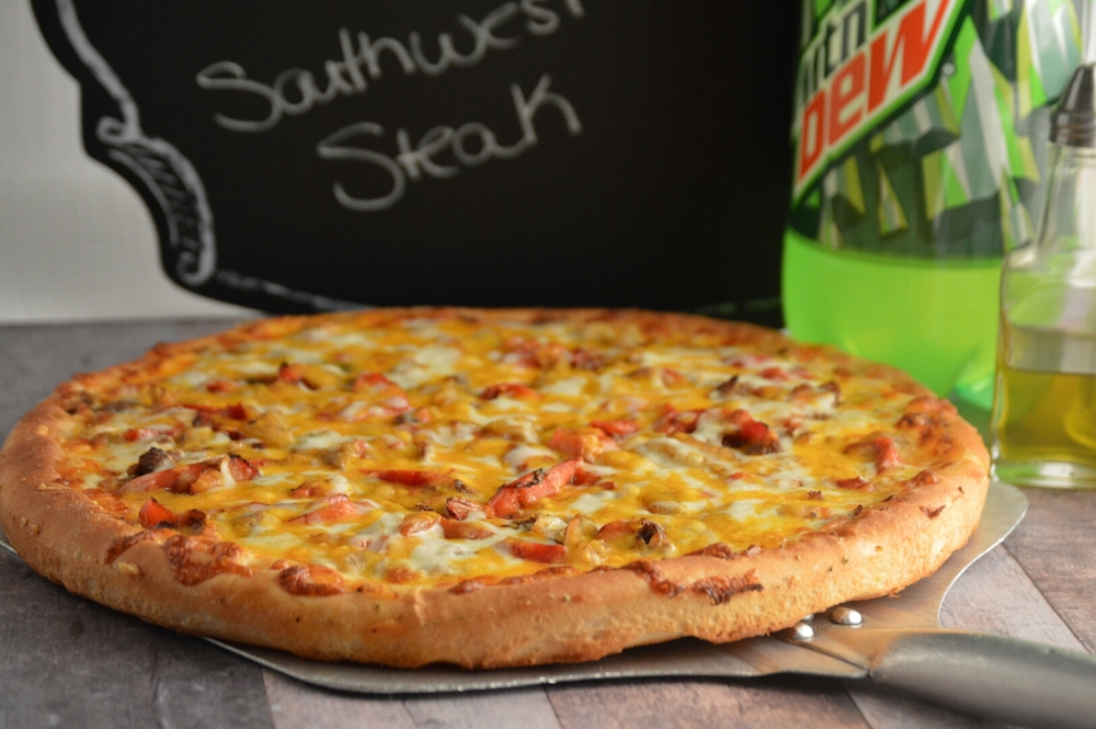 SOUTHWEST STEAK PAN: Southwest ranch dressing, philly steak, roasted peppers, roasted onions, topped with mozzarella and cheddar cheese. (ONLY AVAILABLE IN PAN CRUST)