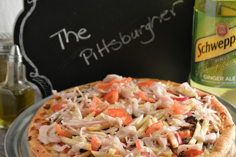 PITTSBURGHER PAN: Ranch dressing, provolone cheese, pastrami and/or philly steak, onions, tomatoes, french fries and topped with homemade slaw.  (ONLY AVAILABLE IN PAN CRUST OR MEDIUM REGULAR CRUST)
