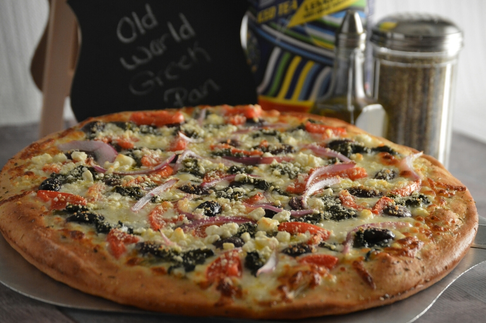THE OLD WORLD GREEK PAN: Garlic-butter or pizza sauce, on our thin pizza crust, provolone cheese, spinach, roma tomatoes, Kalamata olives, onions and feta cheese.