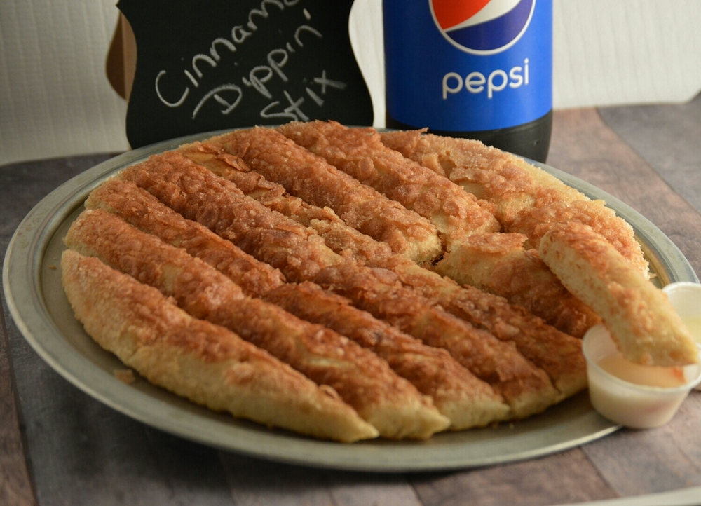 CINNAMON DIPPIN' STICKS: cinnamon-flavored sticks, coated with cinnamon-sugar mix served with apple-cinnamon glaze on top.