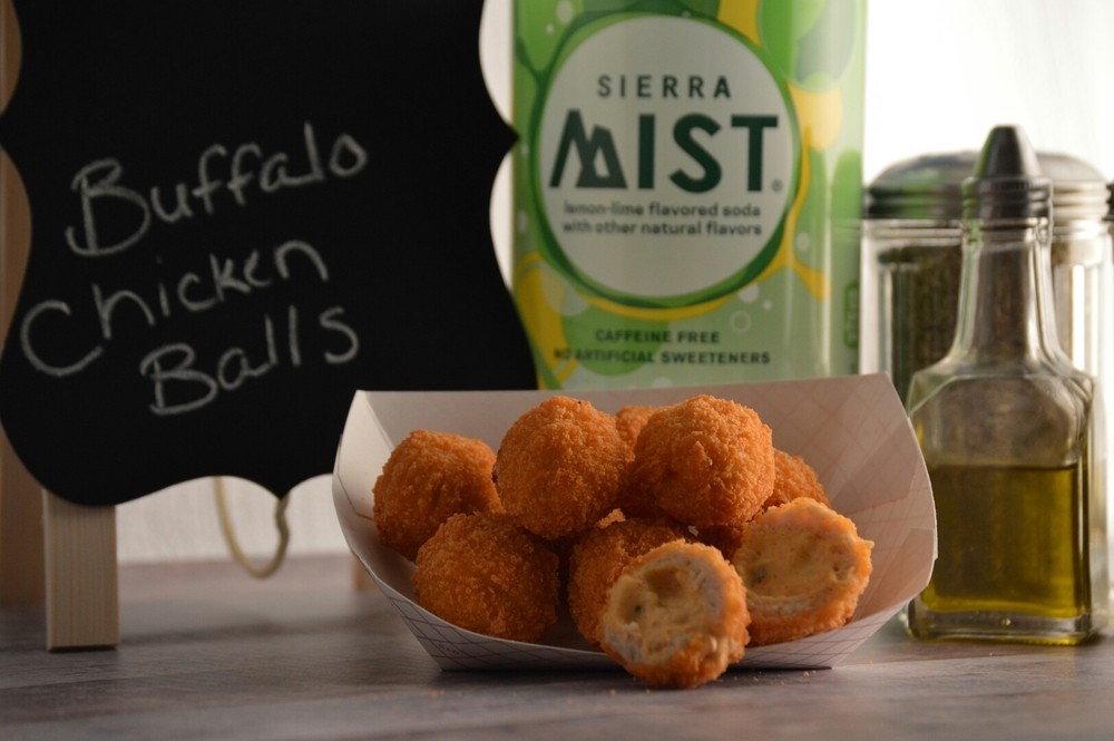 BUFFALO CHICKEN BALLS: Breaded chicken patty filled with cream cheese, celery, bleu cheese and jalapeño peppers.