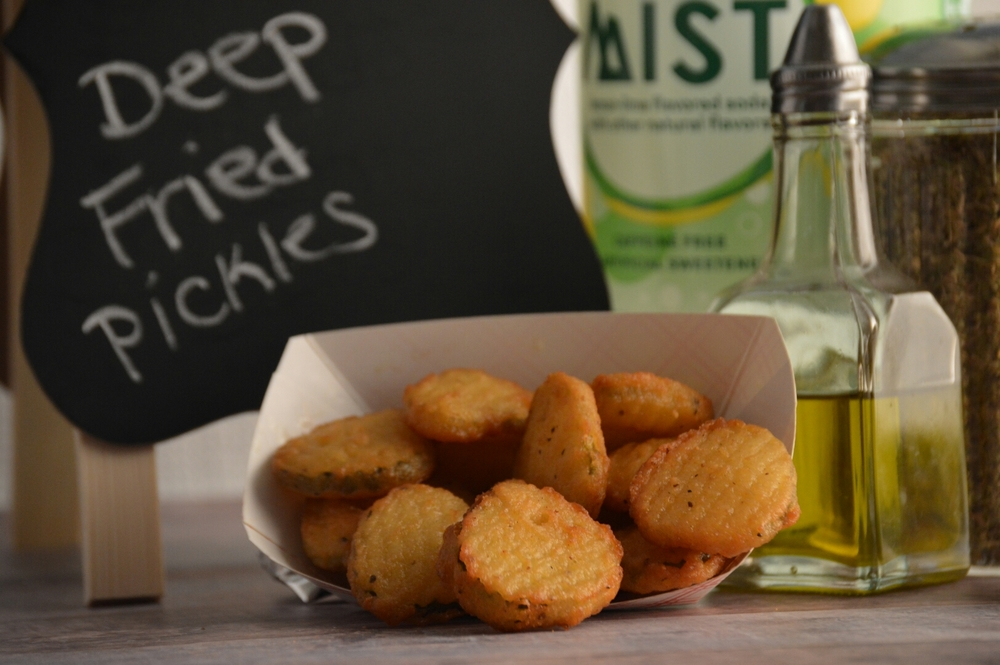 DEEP FRIED DILL PICKLES: Breaded zesty dill pickle chips.