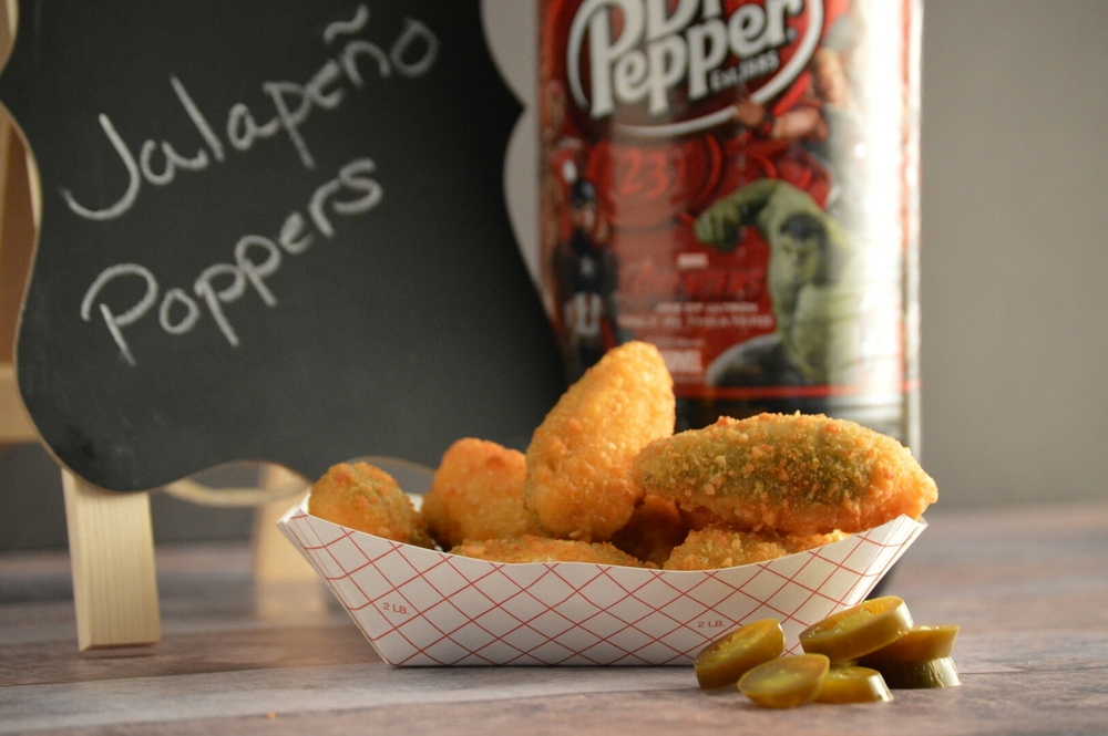 JALAPENO POPPERS: Jalapeno pepper halves, breaded and filled cheddar cheese.