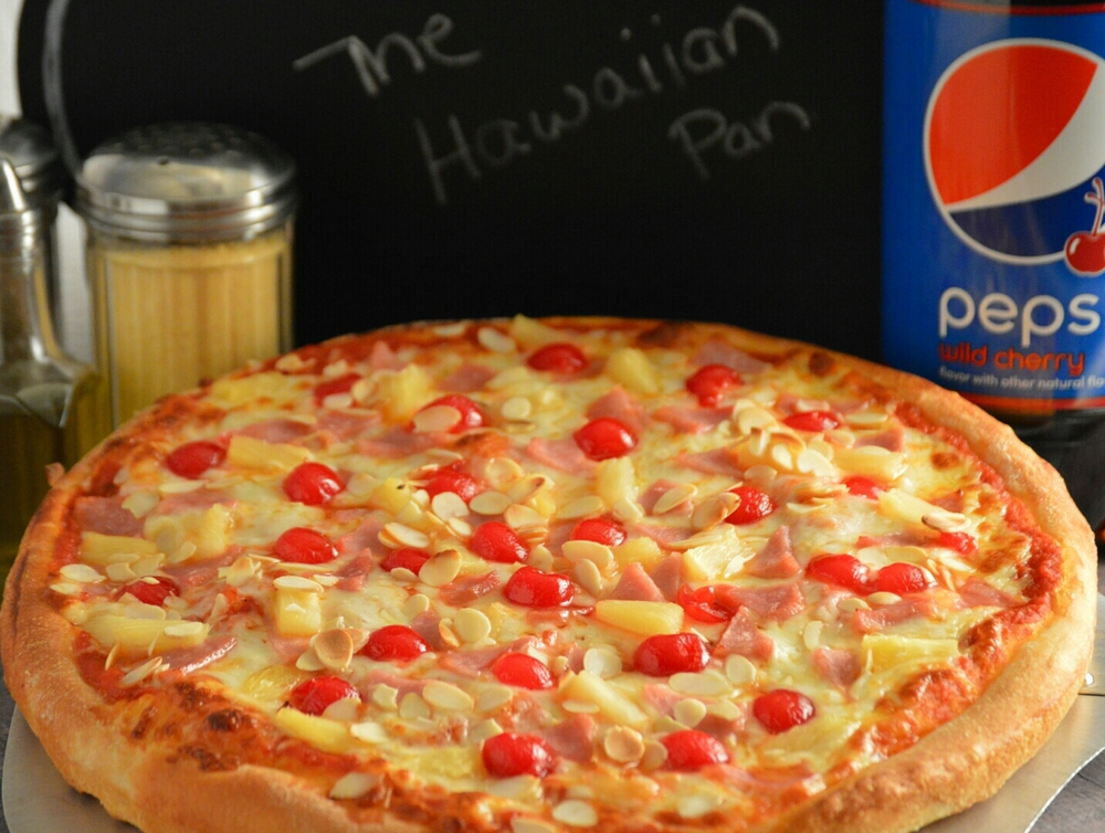 THE HAWAIIAN: Pizza sauce, provolone cheese, pineapple and canadian bacon. DELUXE: add maraschino cherries and sliced almonds.