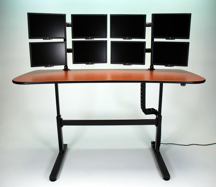 Ergo Mesa height adjustable desk with multiple monitors in raised position.jpg