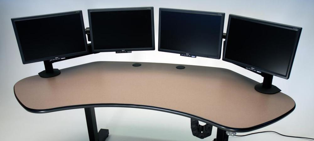 Ergo Solo height adjustable desk shown with 4 monitors_0.jpg