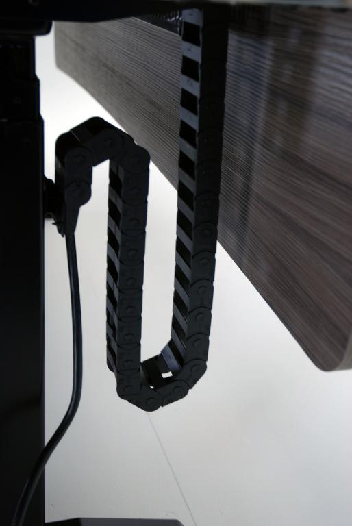 Cable carrier for height adjustable desks.jpeg