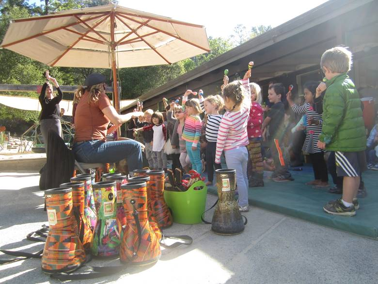 as part of our enrichment program, a  professional drummer leads the children in rythym and movement