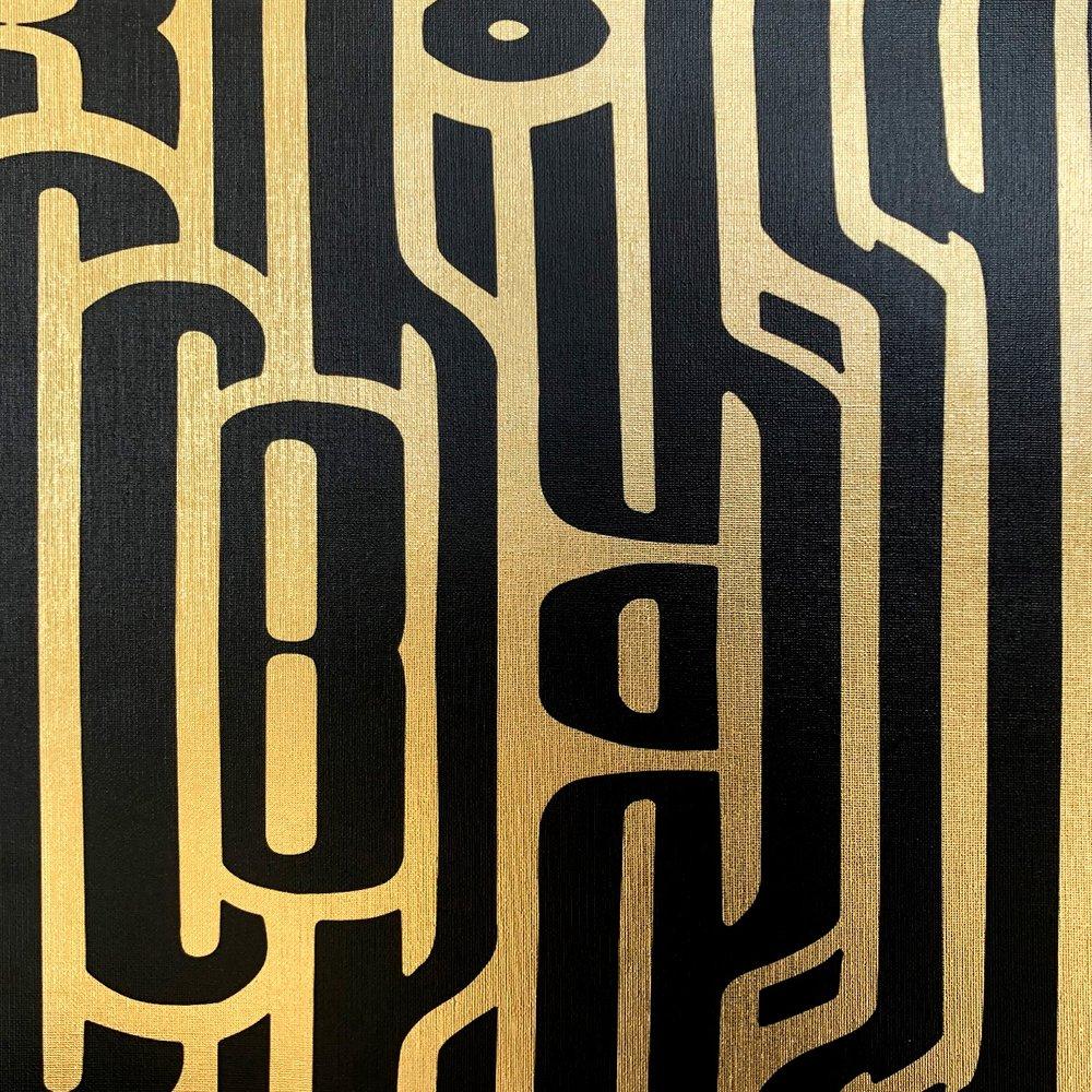 Ritmo Black on textured gold metallic wallpaper