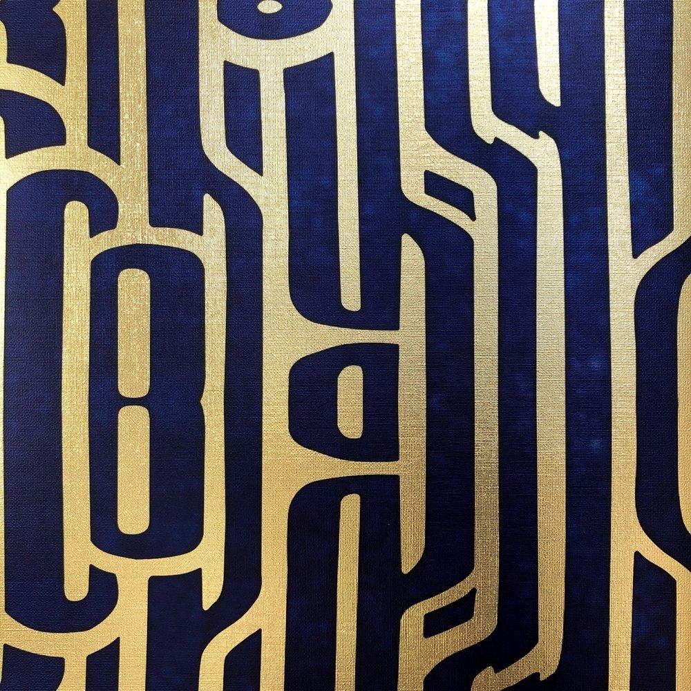 Ritmo Navy on textured gold metallic wallpaper