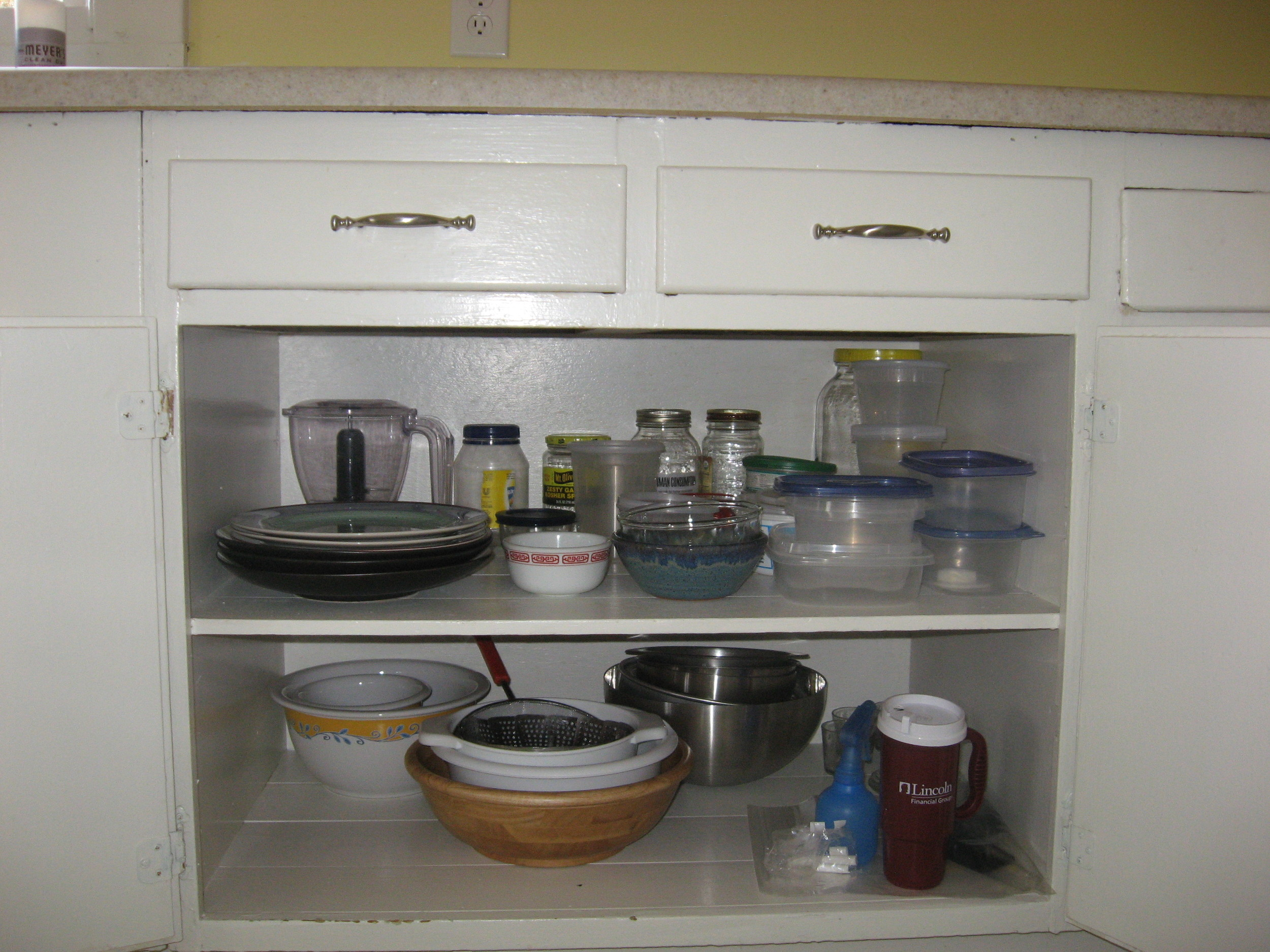 Extra plates, bowls and containers.  It's amazing that a bit of organization can create so much more space.