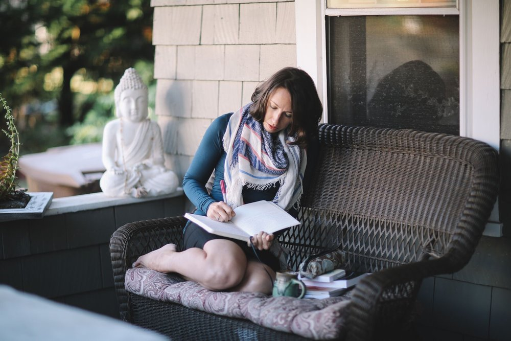 Alisha sitting on the porch writing morning pages Photo by Lindley Battle