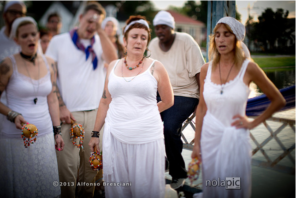 Ceremony in 2013 in New Orleans for Marie Laveau on St . John's Eve. Left to right Sky Bradshaw, Manbo Lorien Bales, Manbo Sallie Ann Glassman