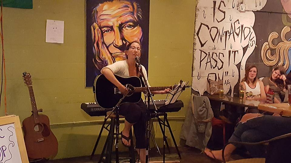 Susan performing at Common Grounds