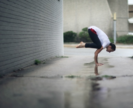 Alisha in Crow Pose in the rain Photo by Lindley Battle