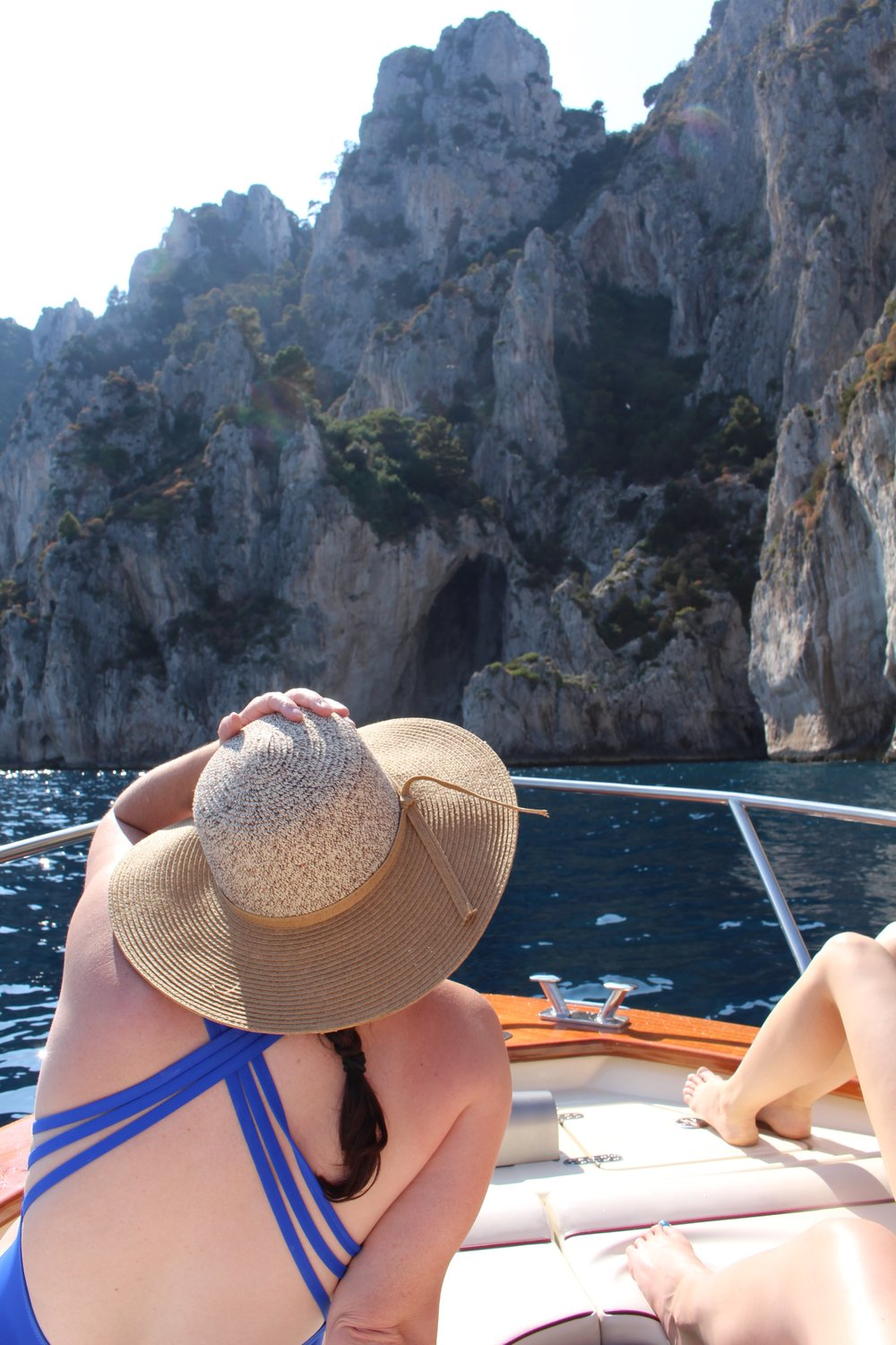 My drop dead gorgeous cousin taking it all in on the boat in Capri, Italy