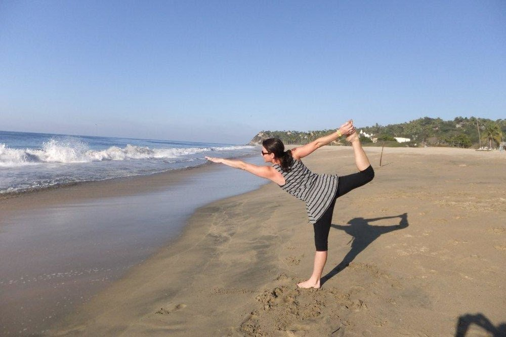 Sara Alvarado in dancer pose on the beach