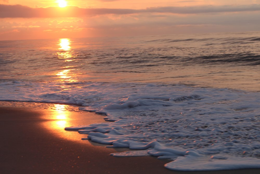 Sunrise reflection in morning tide on Carolina Beach Photo By Alisha Wielfaert