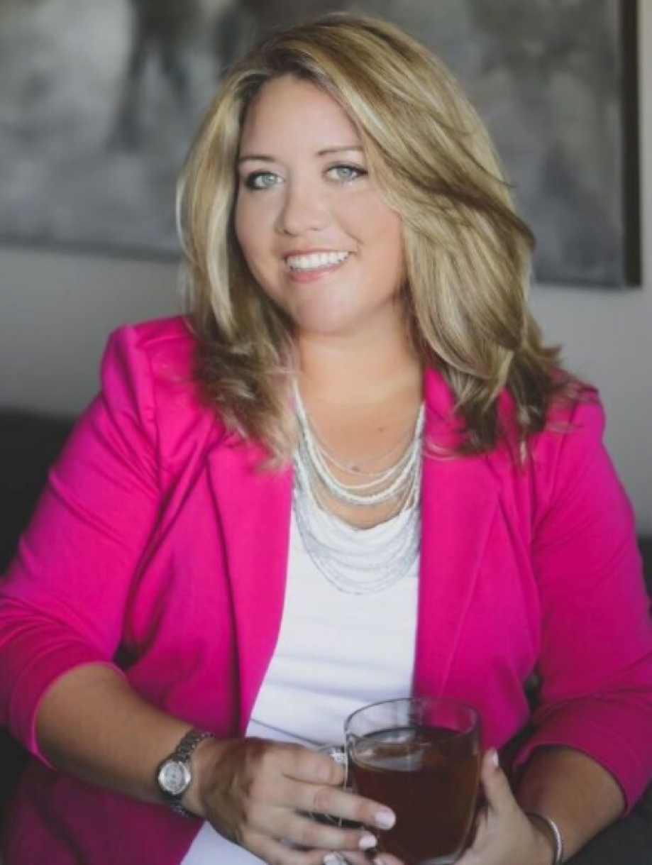 Lauren Hall headshot MDH pink blazer.png