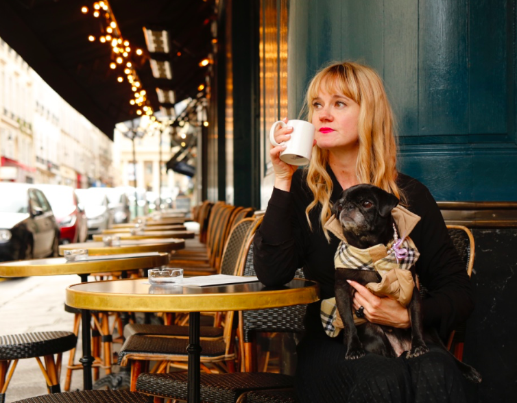 Kimberly Wilson Paris cafe with Pug
