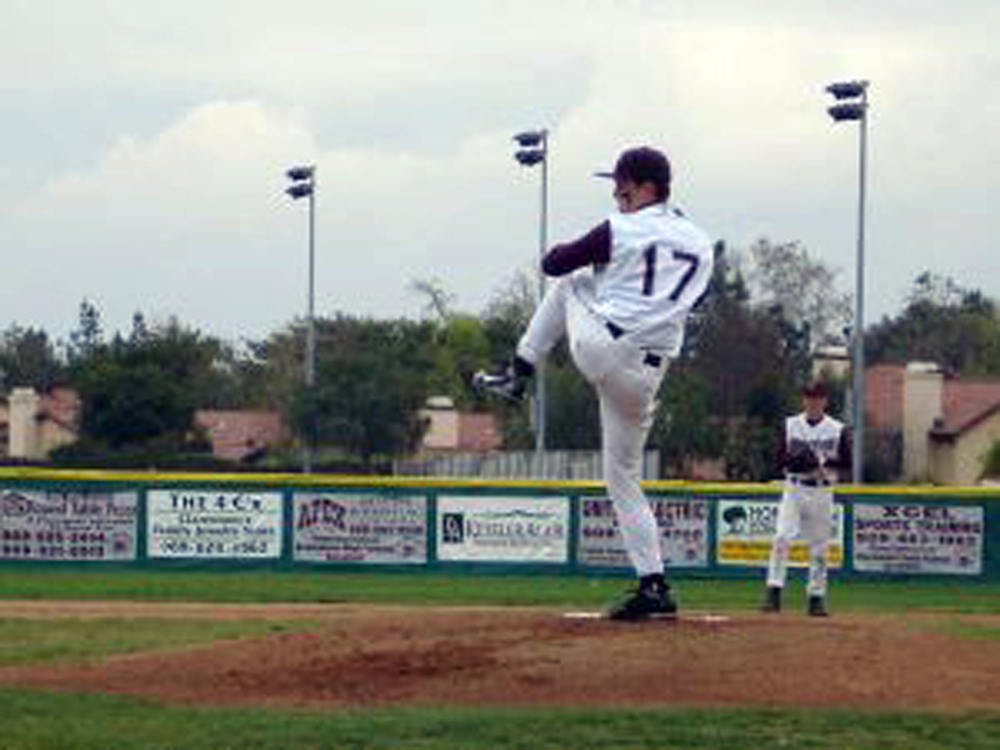 Hal pitching for Claremont HS.