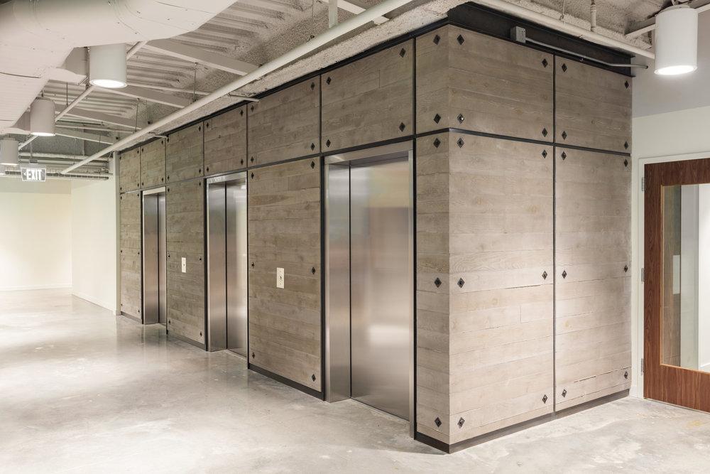 Academy Mortgage Elevator Panels