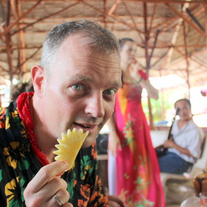 Eating fruit and enjoying local dancers in the Mekong Delta.