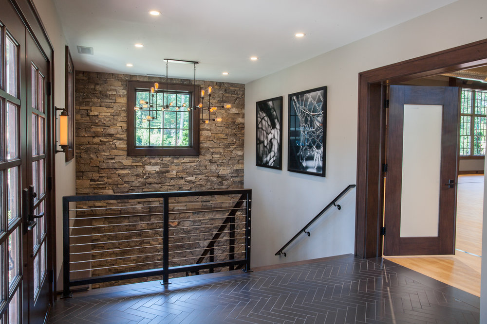 Entry Vestibule Stone Wall - Scott Christopher Homes, Sears Architects, Fuchsia Design