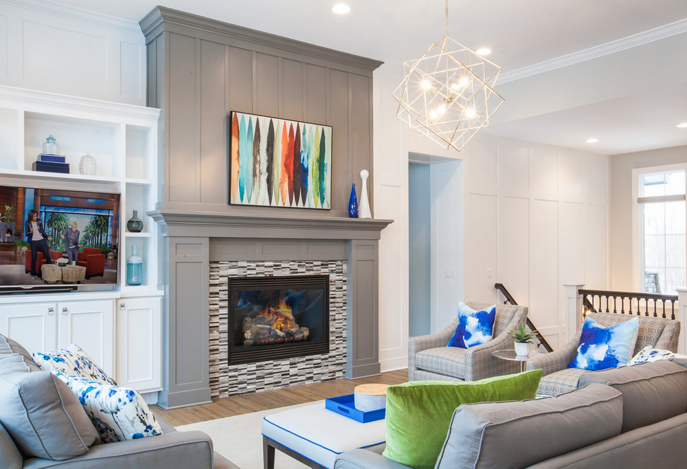 Here, the Chelsea Gray fireplace allows it to pop in this white room and while it's bold, it doesn't feel too heavy in the room.