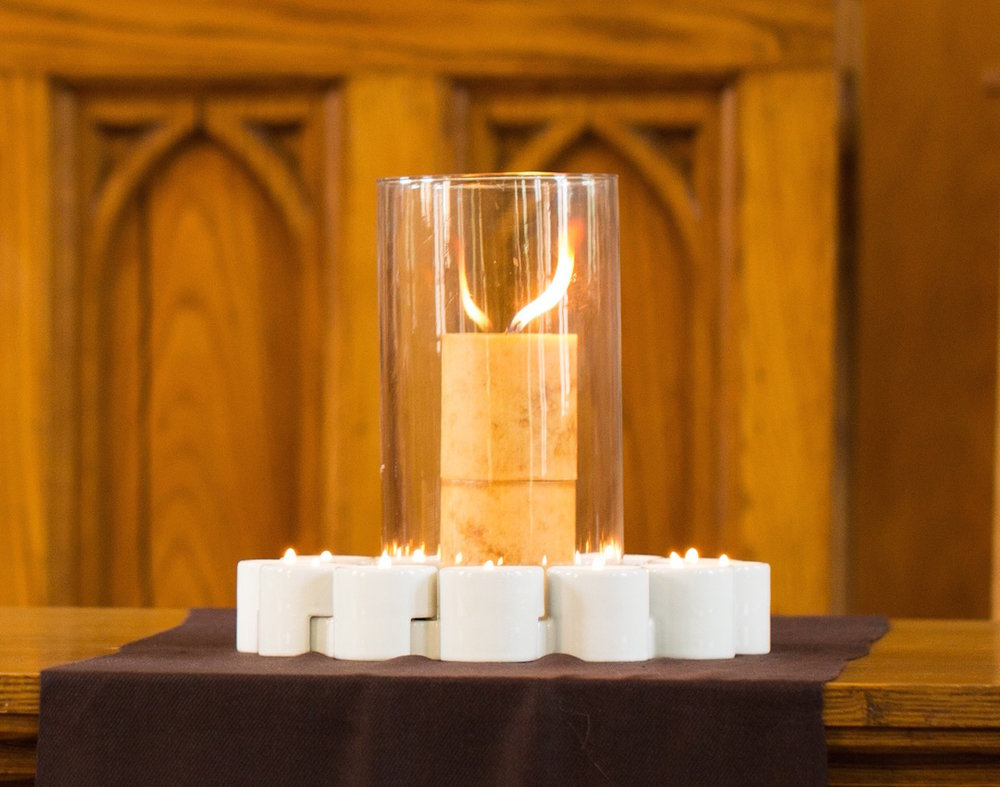 Interlocking candles, a symbol of church membership at Stirling
