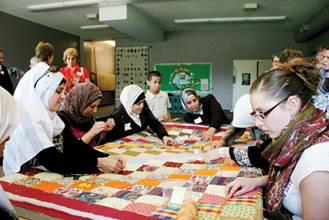 Blanket knotting with Interfaith Bridge Building, out of which the Stirling/Turkish Muslim friendship grew.