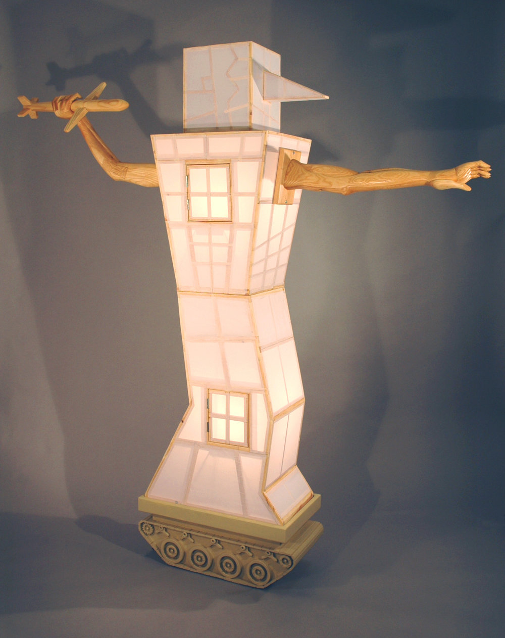 "14.        Title:  Illuminated Man?               Media: Wood, paper, paint, electrical elements,              motors, stones              Dimensions: 82""h x 65""w x 28""d"