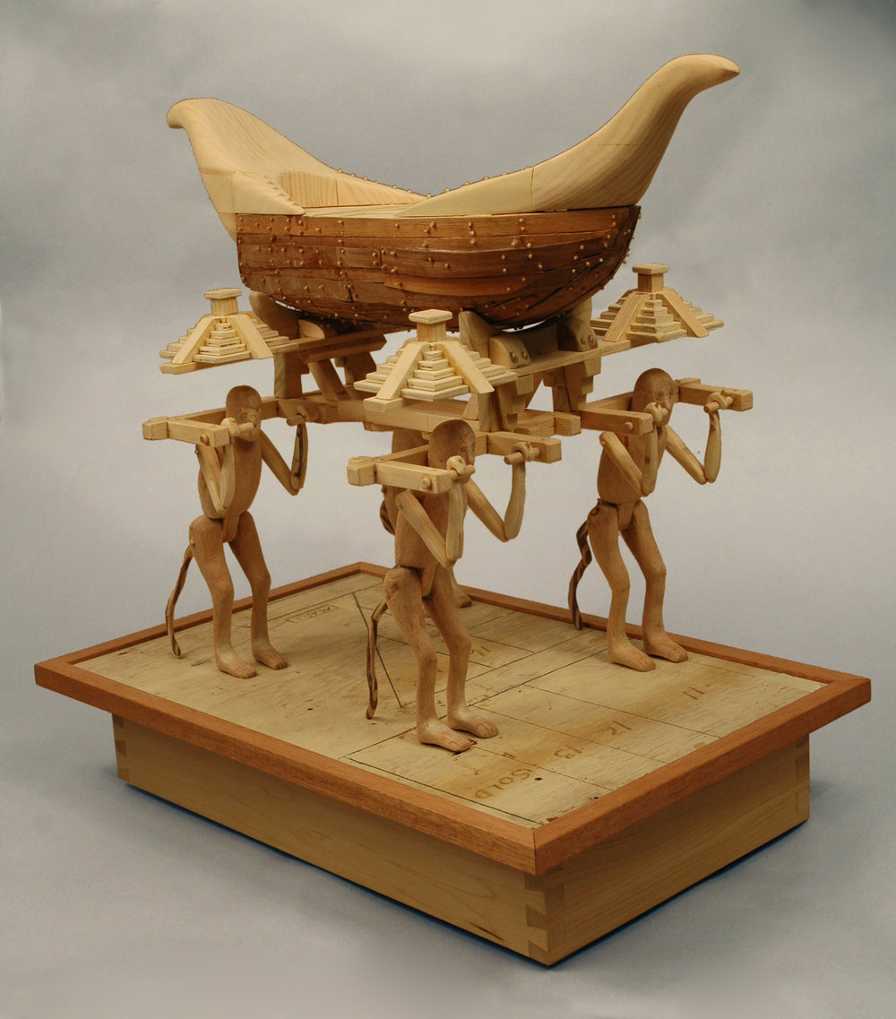 "19.        Title:  The Antediluvian Plan of                 the Manikin Men (from the Popol Vuh)               Medium: Wood, paint              Dimensions: 25""h x 33""w x ""d"