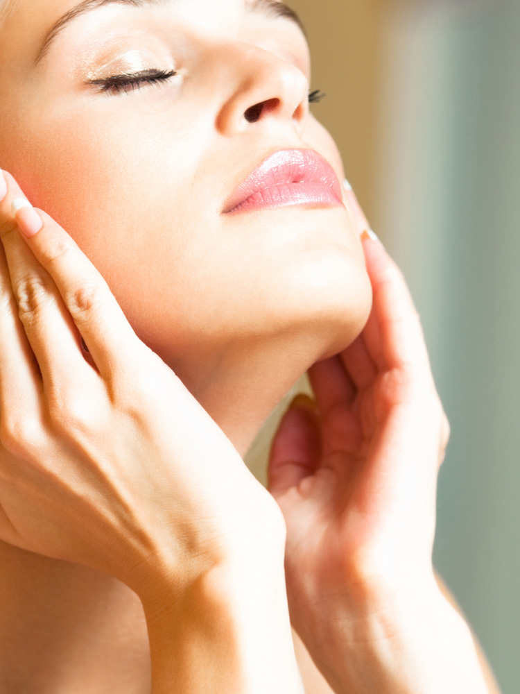Summer Skincare: Woman Applying Moisturizer with SPF
