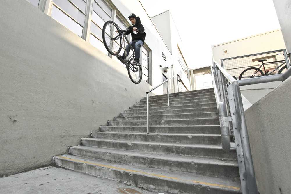 staircase gap jump with fixed gear rider michael chacon