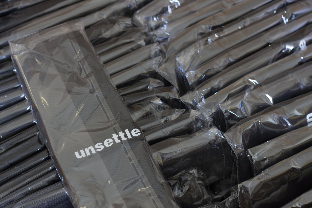 unsettle-co-lifestyle-blog-behind-the-scenes-shipping-day-commuter-rolltop-unroll