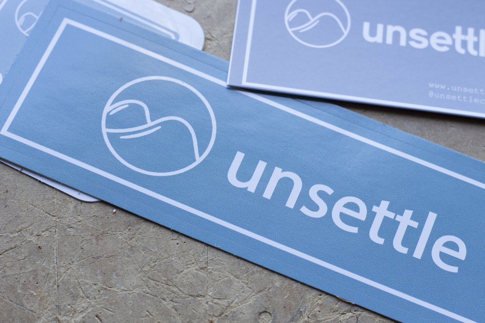 unsettle-co-lifestyle-blog-behind-the-scenes-shipping-day-commuter-rolltop-backpack-stickers