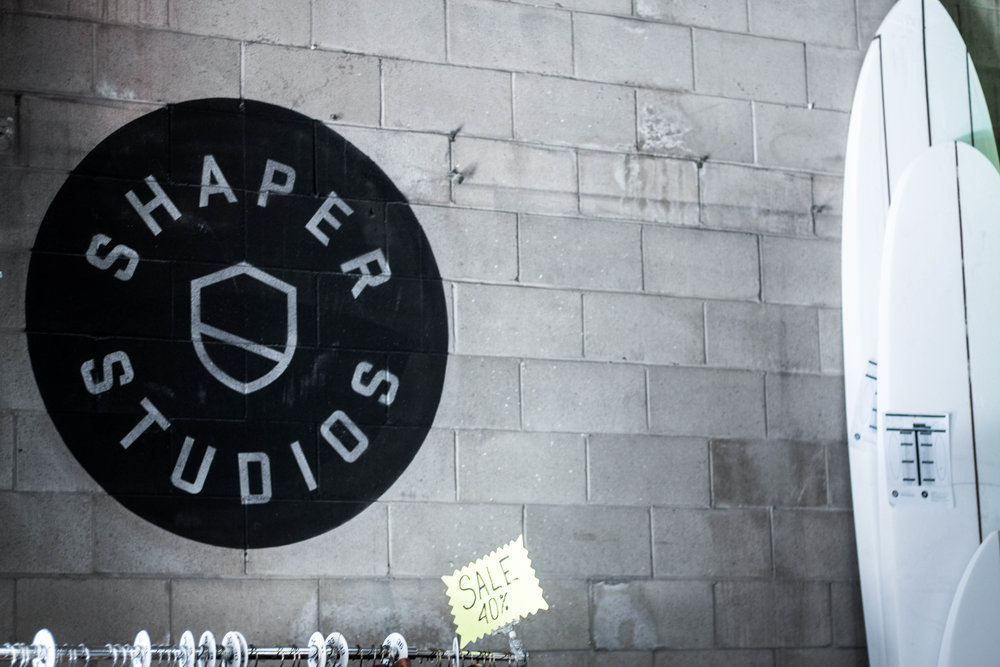 unsettle-lifestyle-blog-spaces-surf-shop-shaper-studios-san-diego-logo