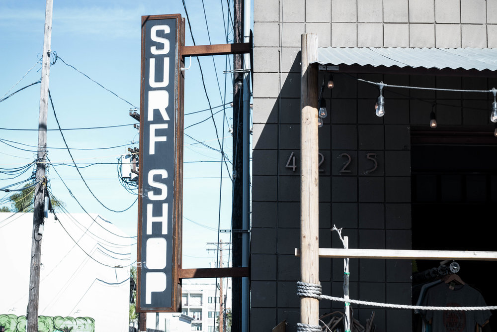 unsettle-lifestyle-blog-spaces-surf-shop-shaper-studios-san-diego-front-sign