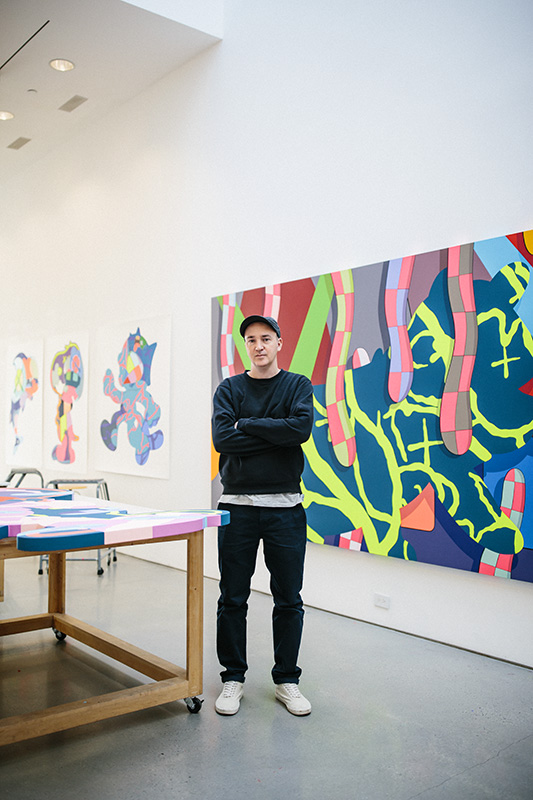 portrait of kaws the artist in kaws art studio