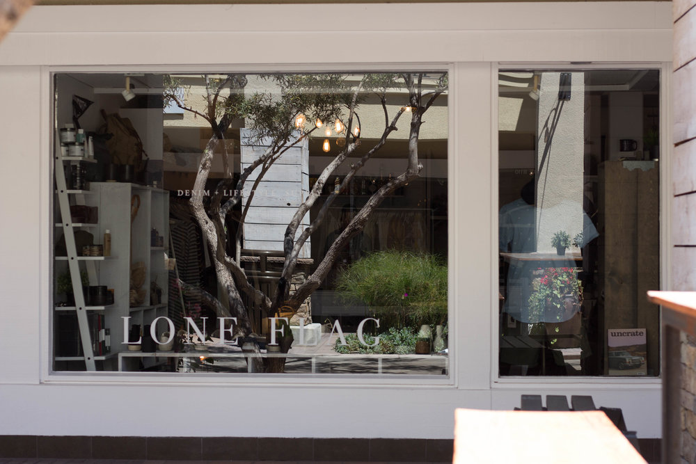 front entrance of lone flag menswear store