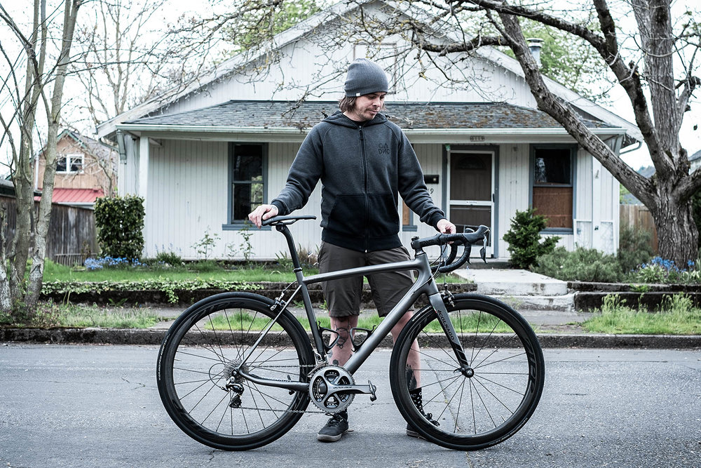 portrait of patrick thames of pedalconsumption and his colnago bike