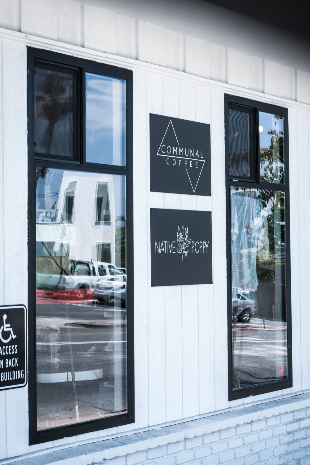 the front door of communal coffee and native coffee in san diego