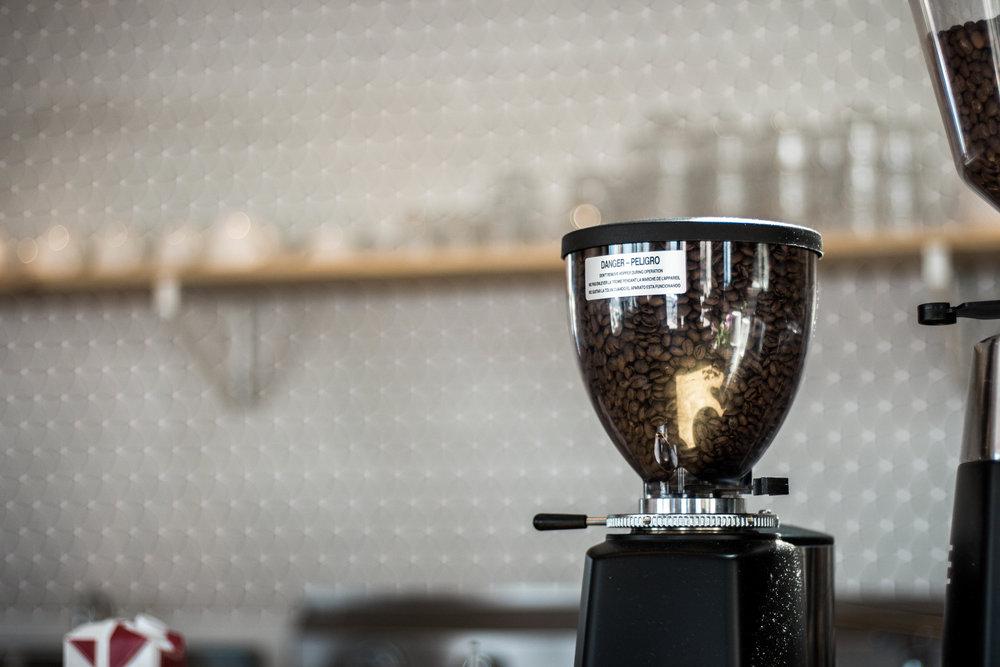 close up of coffee grinder at communal coffee