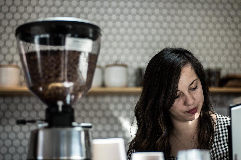 a coffee barista brewing coffee at communal coffee