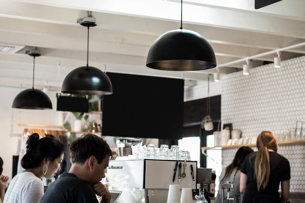 interior lighting decor with people working at a coffee shop