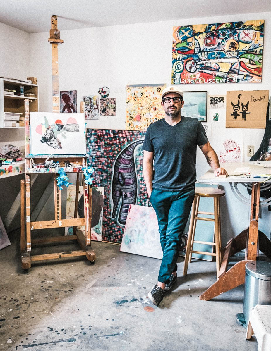 a portrait of bret brown the artist in his art studio